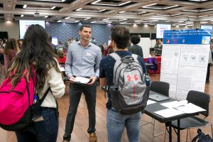 Sergei Gleyzer speaking with students at the Faculty Research Fair